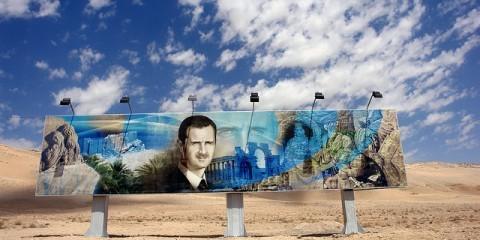 Bashar al-Assad mural along the Damascus to Aleppo highway / Flickr / James Gordon / CC BY 2.0