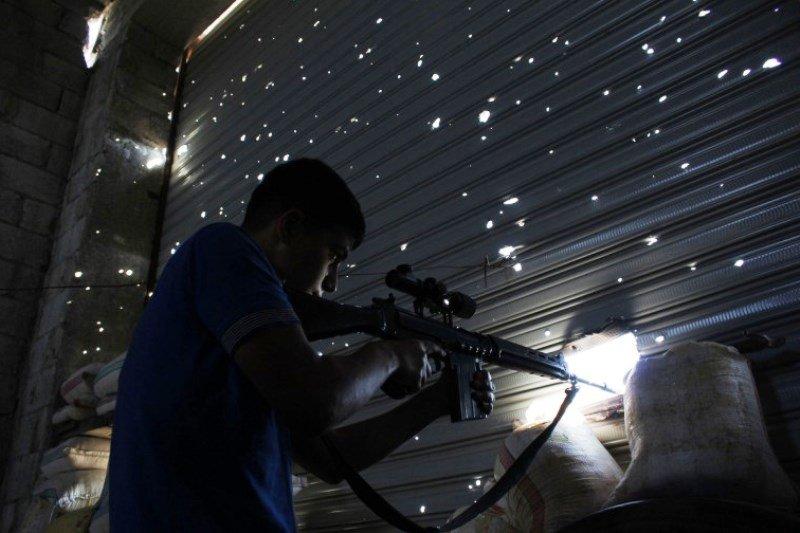 Free Syrian Army fighter in Aleppo / Flickr / Jordi Bernabeu Farrús / CC BY 2.0